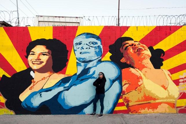 Ana Maria Cruz alias Ana Formismo in front of her mural in Ciudad Juarez, Mexico.