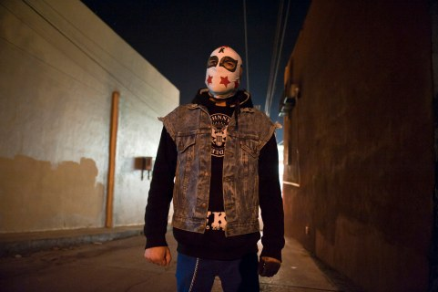 Musician Carlos Velazquez, a member of the punk band Tripa Revancha in Nogales, Mexico. The band usually wears suits and wrestling masks on stage. LA FRONTERA: Artists along the US Mexican Border © Stefan Falke http://www.stefanfalke.com/