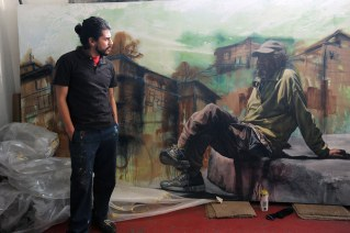 "The artist and muralist Alfredo Gutierrez with his portrait of an American homeless man in Tijuana, Baja California, Mexico. Q: ""What is the essence of your life as a border artist?"" A: ""To take the best from two worlds, two realities, two chaos, to have a balance with the entropy that society creates with the idea of creating my own language throughout art."" This picture is part of my long-term project LA FRONTERA: Artists along the US Mexican Border. © Stefan Falke / www.stefanfalke.com"