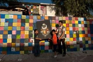 Efren De La Cruz, painter, at his free apartment in an drug infested part of Mexicali, Mexico. © Stefan Falke http://www.stefanfalke.com/