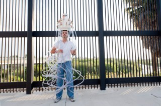 Matamoros artist Mauricio Saenz at the border fence in downtown Brownsville, Texas, USA. This picture is part of my long-term project LA FRONTERA: Artists along the US Mexican Border. © Stefan Falke / www.stefanfalke.com